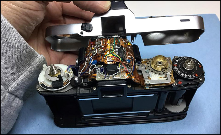 Removing the top plate of a Minolta XD-11 camera.